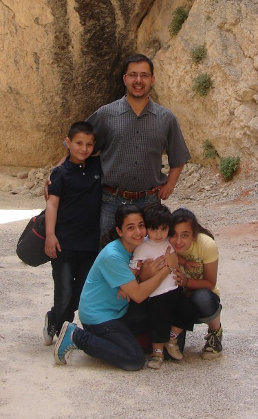 Test caption for Malak Shalabi family photo.