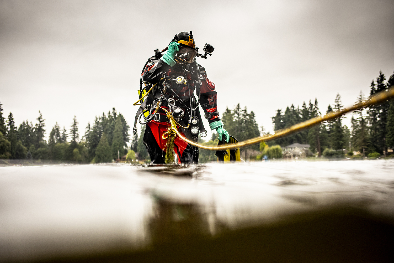 An EPA diver deploys instruments in Lake Killarney, where a team of UW researchers is exploring how arsenic travels from the lakebed to the food web. (Photo by Dennis Wise)