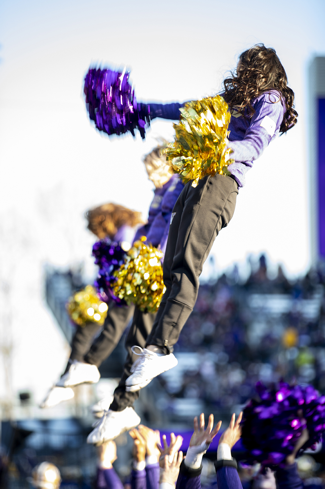 UW Cheer mid-routine during the 112th Apple Cup, which the Huskies won 31–13 in their seventh consecutive victory over Washington State University. Photo by Dennis Wise