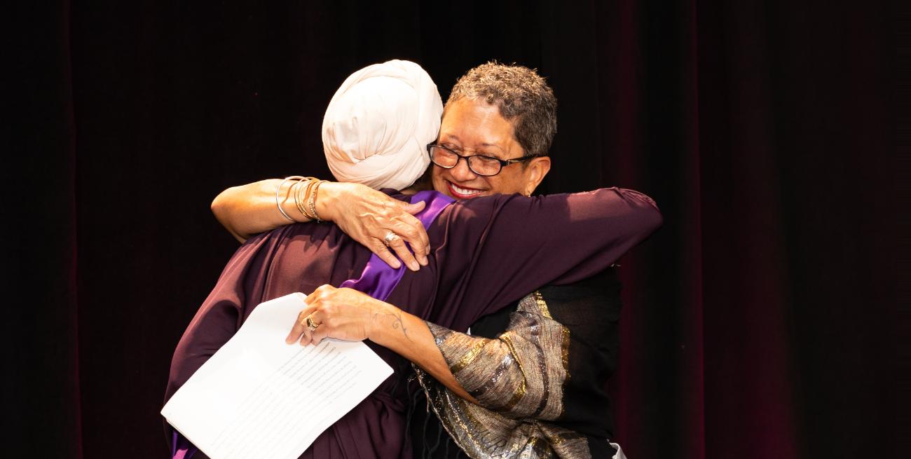 Ayan Hassan and Dr. Patricia Dawson share a hug