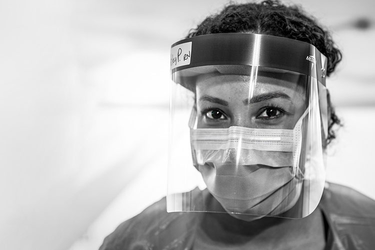 Medical worker wearing face mask and face shield