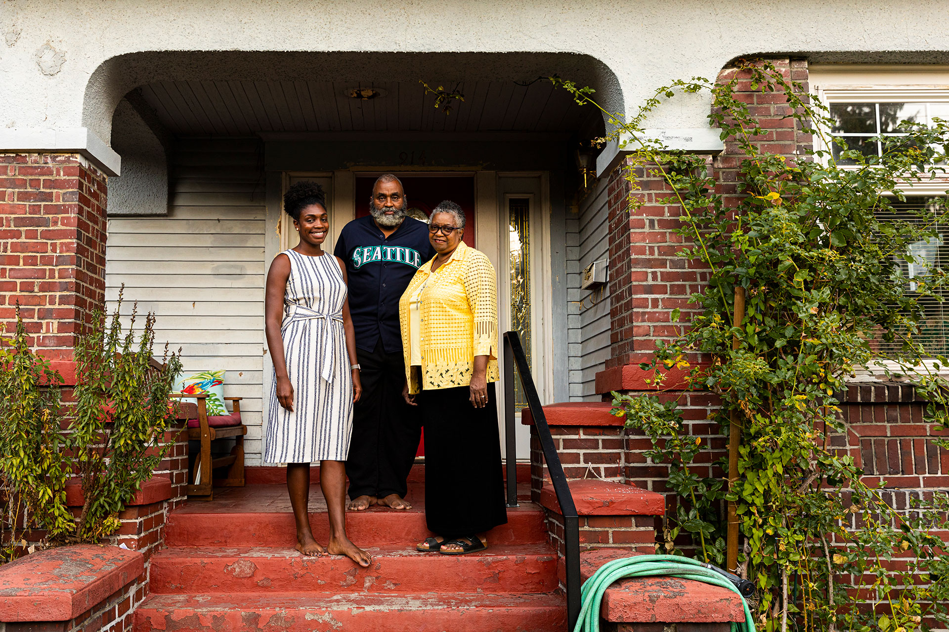 Dr. Danyelle Thomas, pictured here with her parents at her family home, returned to Seattle's Central District for her medical residency.