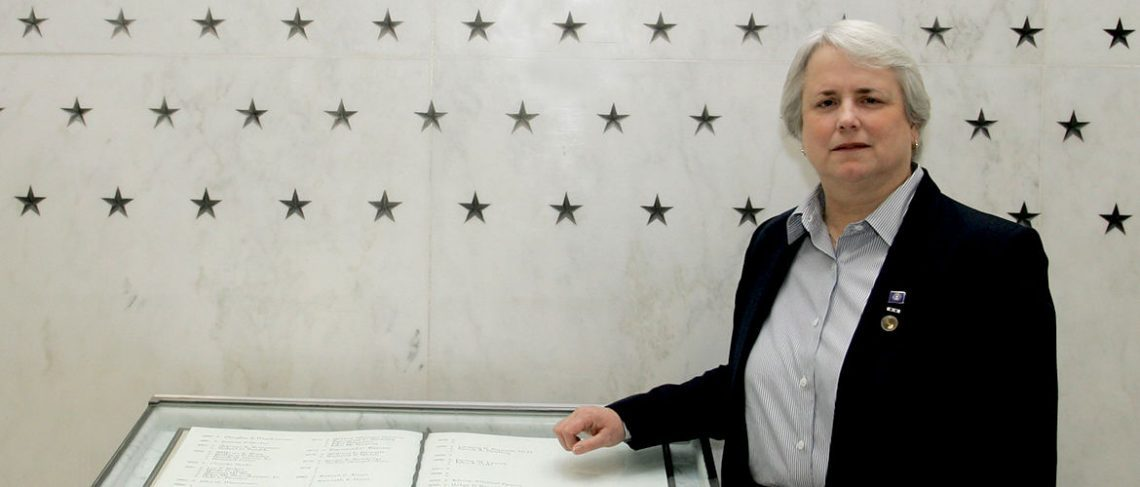 Noyes spent decades climbing the ranks — and mentoring others — in the CIA. Here, she pauses at the CIA Memorial Wall on the day of her retirement in 2006.