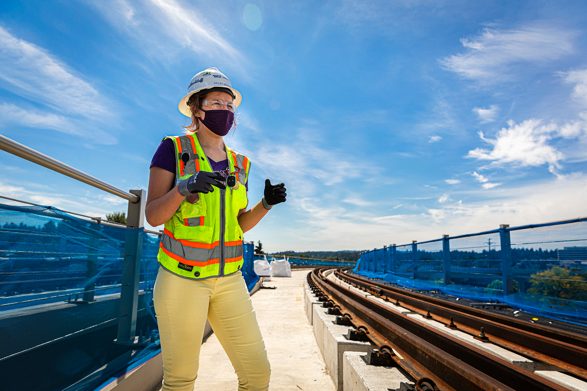 Civil engineering student Bailey Griffin conducts work at an intership with contract company for the Sound Transit eastside light rail project