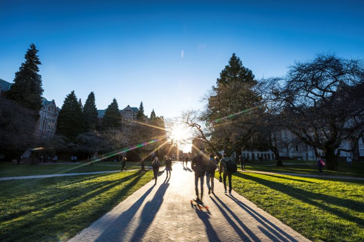 Students walk across the Quad on campus