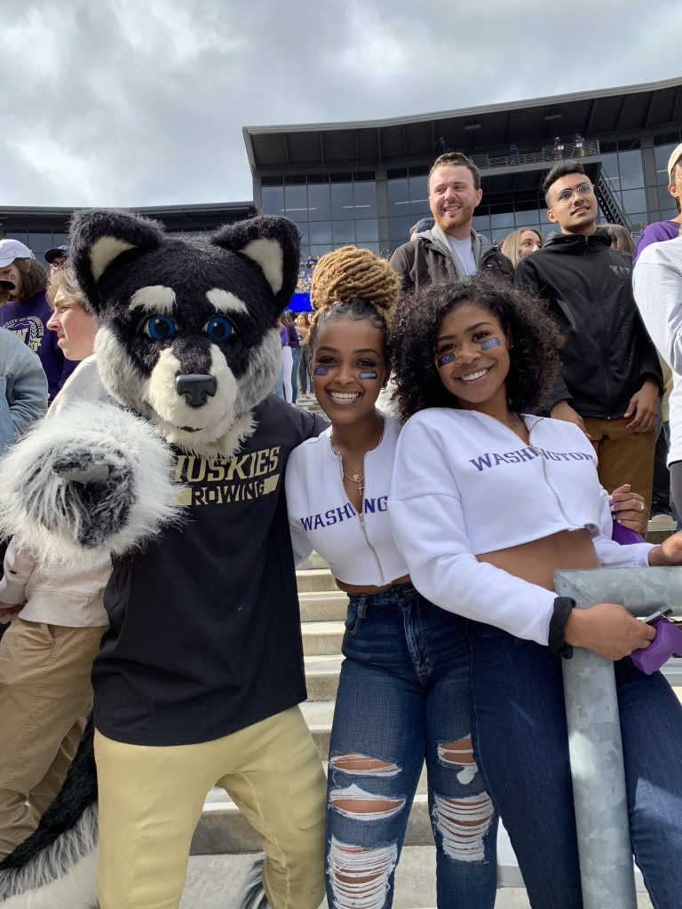 Ruth at a Husky game with Harry the Husky
