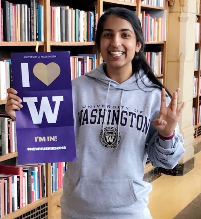 "UW student with ""I love UW"" sign"