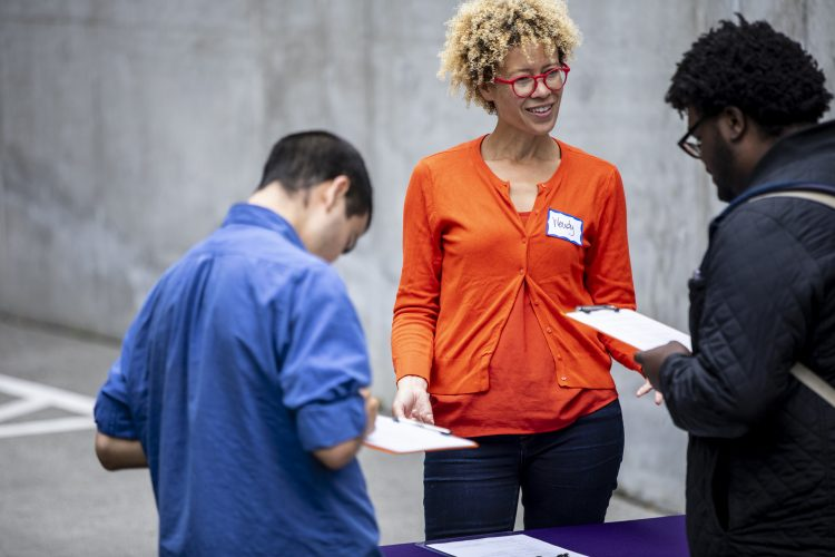 Wendy Barrington talks with visitors at a Doorway Project event.