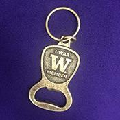 UWAA keychain on purple background
