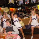 Inside the Northlake Tavern with Husky cheer squad performing while people eat pizza