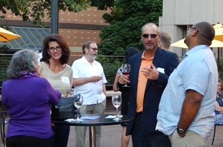 Huskies gather for a happy hour at the Oregon Historical Society in downtown Portland.