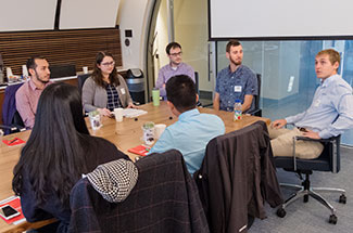 Recent graduates share their career journey as part of an employee panel.