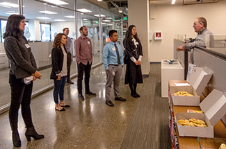 Students tour the PEMCO office