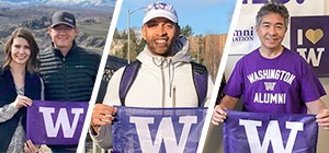Three volunteers hold UW flags