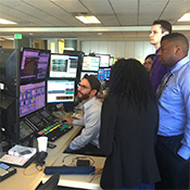 Students see a worker operate professional softwares