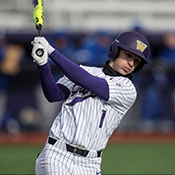 UW Men Baseball player wield baseball bat