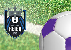 Seattle Reign logo and soccer ball with a turf field background