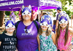 A mom and three girls with dawg masks covering the upper part of their faces