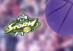 Seattle Storm logo with basketball and blurry background