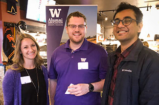 Three alumni at a Husky social