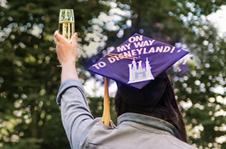 student at grad toast