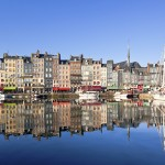 Honfleur, known for its old port, characterized by its houses with slate-covered frontages