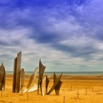 Les Braves Sculpture, a nine-meter tall stainless steel sculpture by Anilore Ban that honors the men who landed here on Omaha Beach to liberate France.