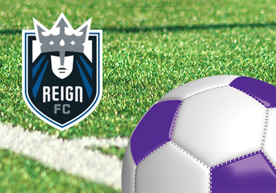 Turf field closeup with purple and white soccer ball and ReignFC logo