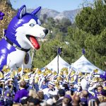Large inflatable Husky dog with Husky marching band and crowd