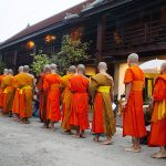 Buddhist monks lined up outside temple, Luang Prabang, Luang Prabang, Laos