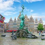 Silvius Brabo Fountain with the Guild houses in the background, Main Square (Grote Markt), Antwerp, Belgium