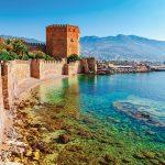 Stone seawall meets the coastline in Alanya, Turkey