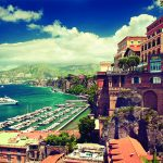 Sorrento place. Amalfi coast. Italy. Cliff ,beach and boat pier.