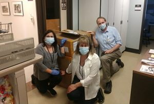 Hall Health staff receive a donation of PPE from the China Huskies