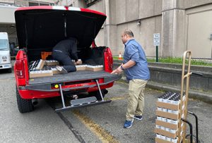 Unloading a donation from the Mask4WA campaign