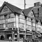 Historical black and white photo of the College Inn Building