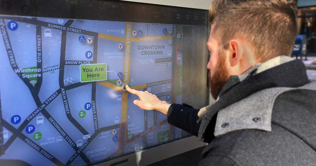 Post Hero Image: man using a smart kiosk