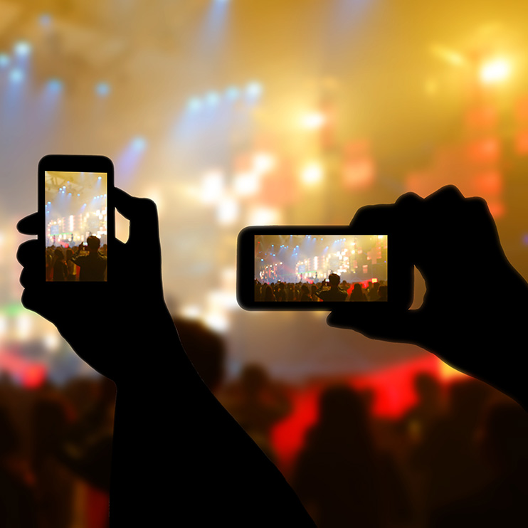 Filter Page Image: smart phones being used at a concert