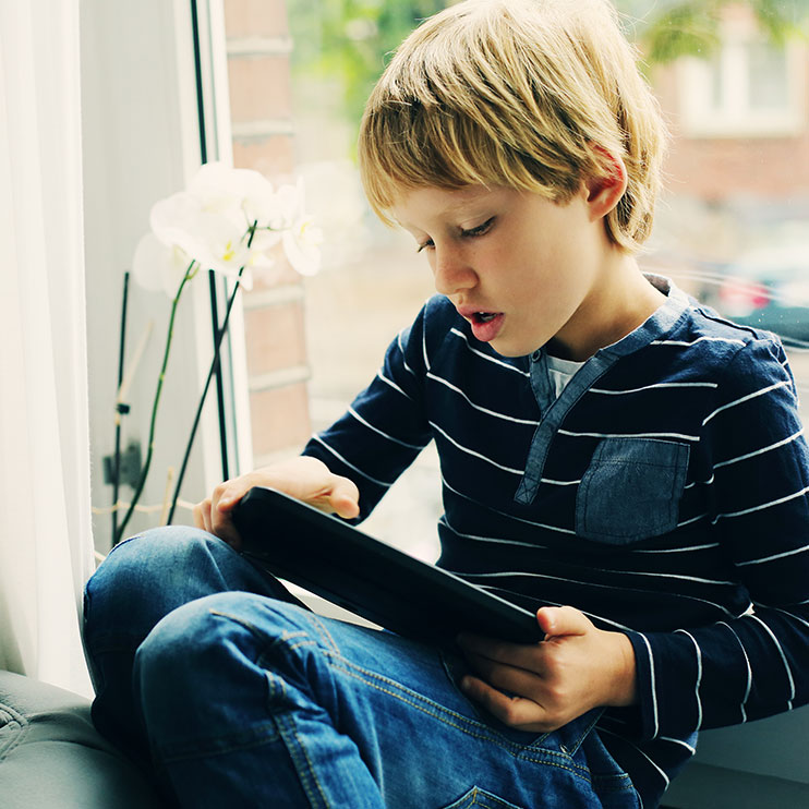 Filter Page Image: Child with tablet