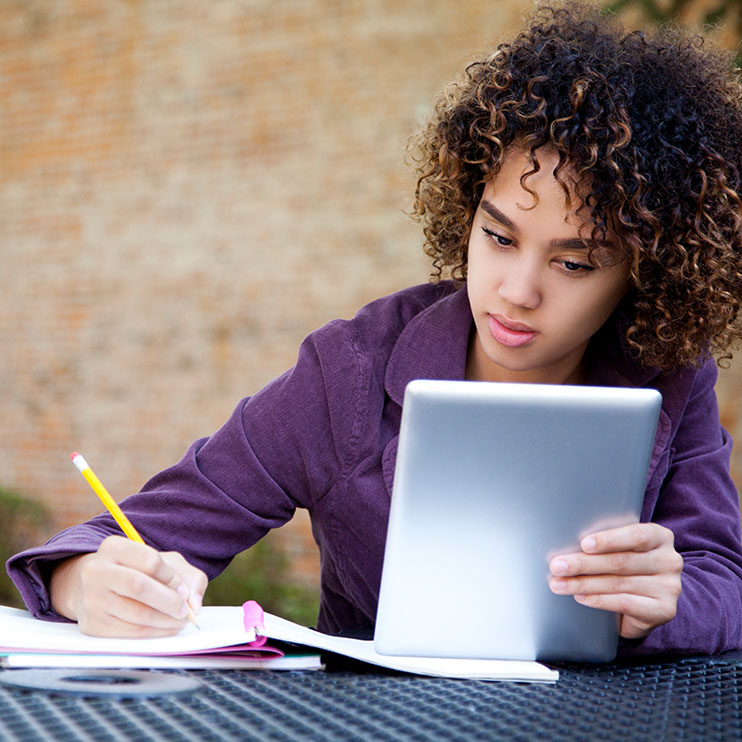 Filter Page Image: young ethnic woman using a tablet to study