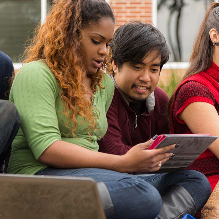 Filter Page Image: diverse college students sharing a tablet