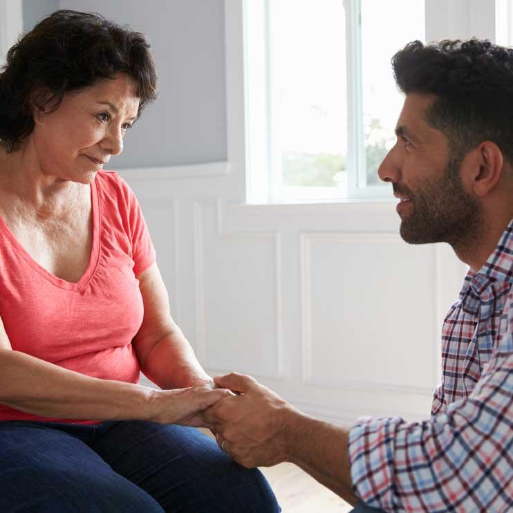 Filter Page Image: Man comforting senior hispanic mother