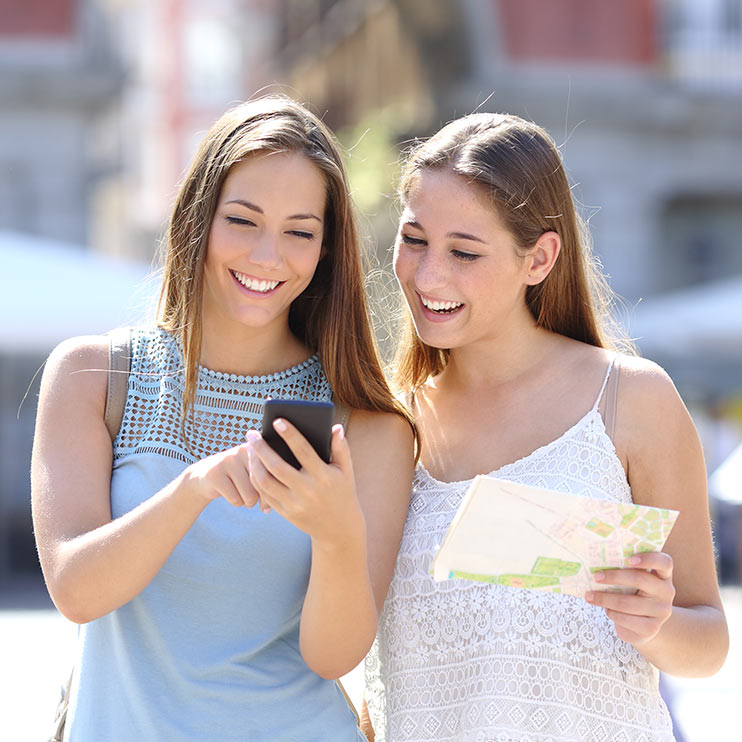 Filter Page Image: two girls using phone navigation