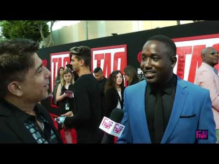 "Hannibal Buress at the ""TAG"" red carpet cracking jokes"