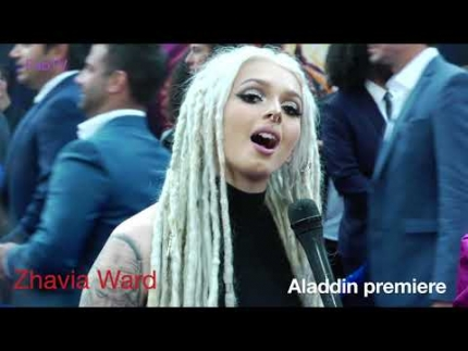"Zhavia Ward performs on the purple carpet  at the  ""ALADDIN""  premiere"