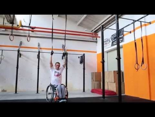 Wheelchair muscle up to forward roll