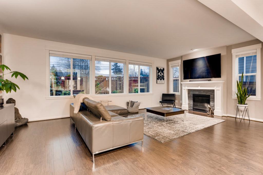 Top real estate image of living room with tv over fire place