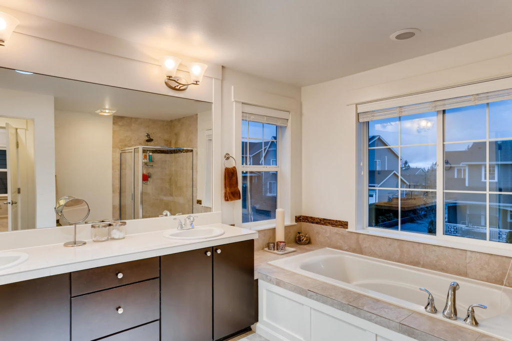 top real estate image of bathroom with tub and windows