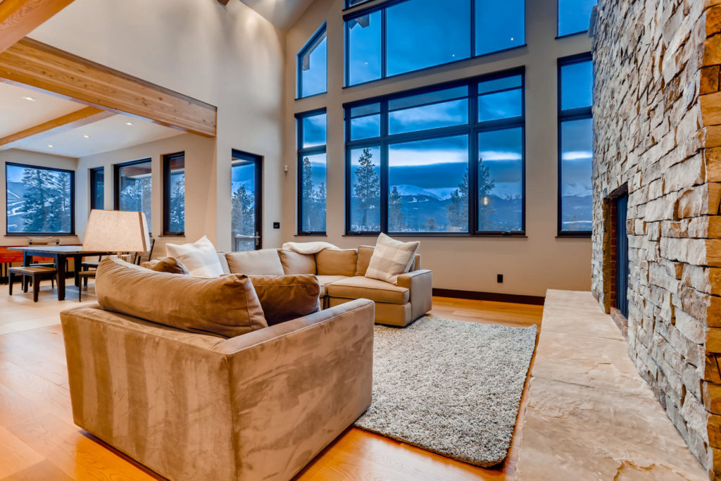 real estate listing image of living room in mountain home - virtuance