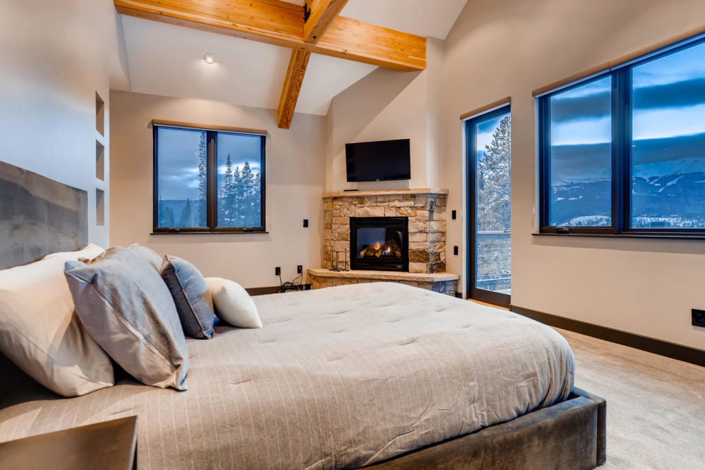 real estate image of bedroom in modern mountain home - virtuance